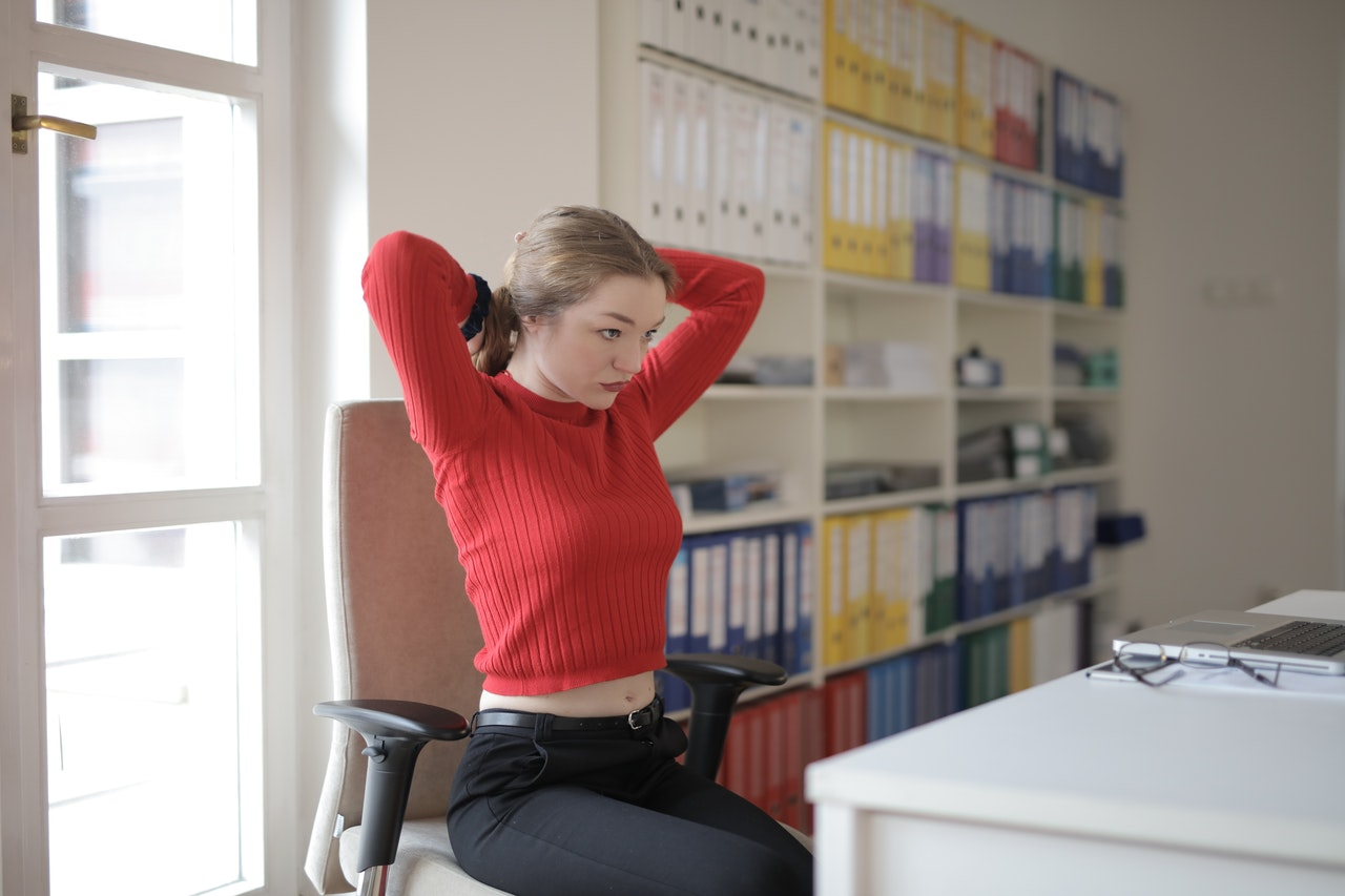 girl doing stretching exercises at the office desk